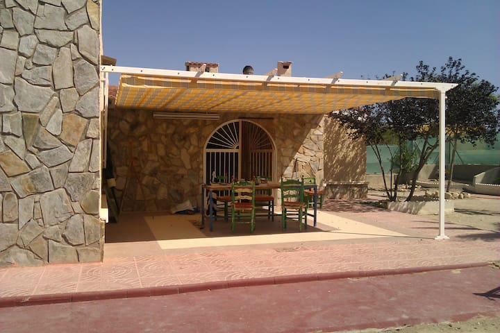 external kitchen, breakfast area in summer