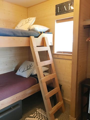 Bunk room with built-in twin beds