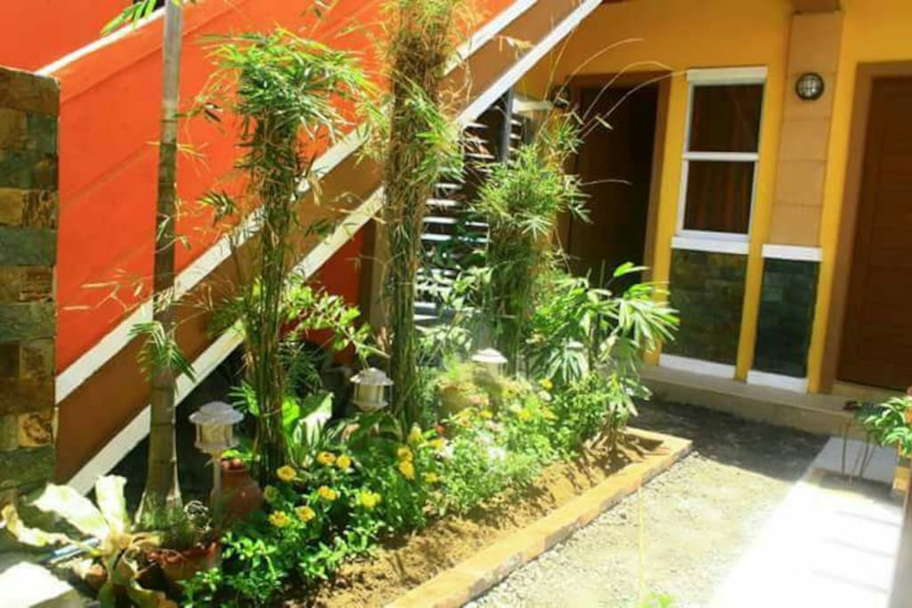 The stairs going to the roof deck. The door in this picture is Room 1, which is nearest to the gate going to the beach.