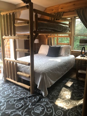 Comfy Queen bed with twin bunk above.