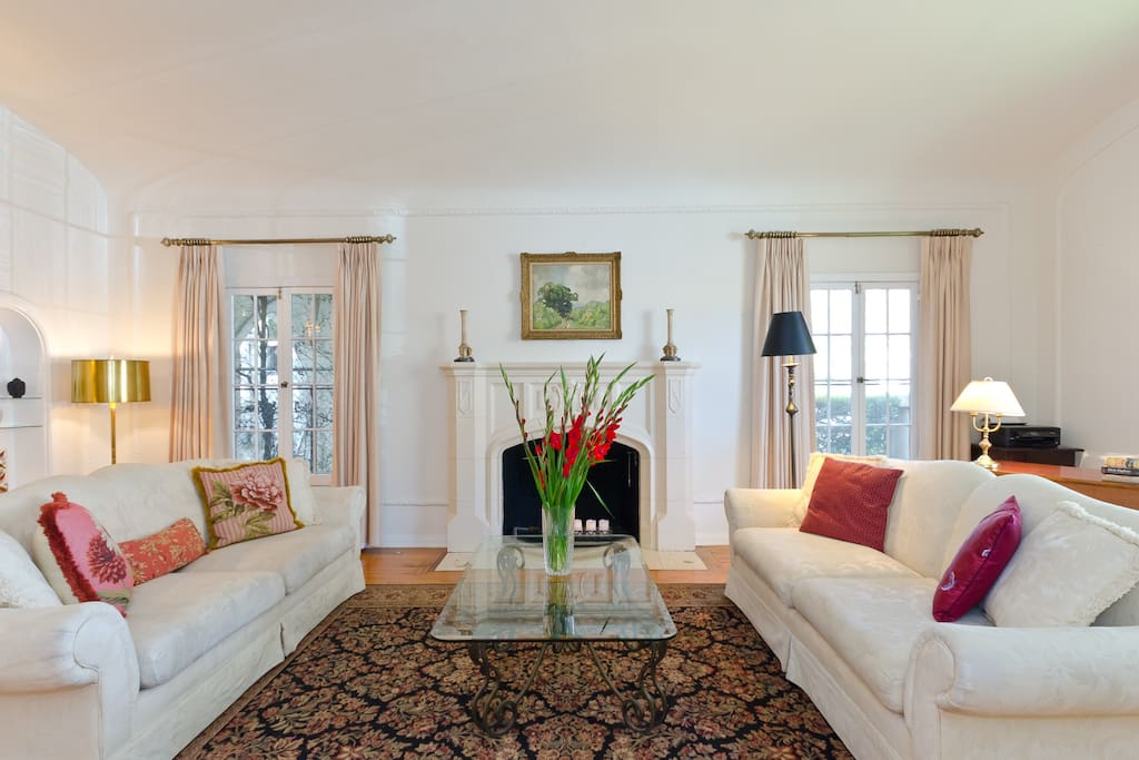 Relax in the living room with 2 comfortable sofas, beautiful fireplace and mantle.