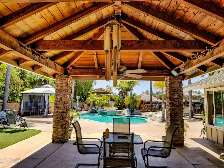 your own backyard with the works. pool ,Jacuzzi, bbq, tiki rooms, bar, gazebo, table, loungers, gravity chairs,kids play pen etc..