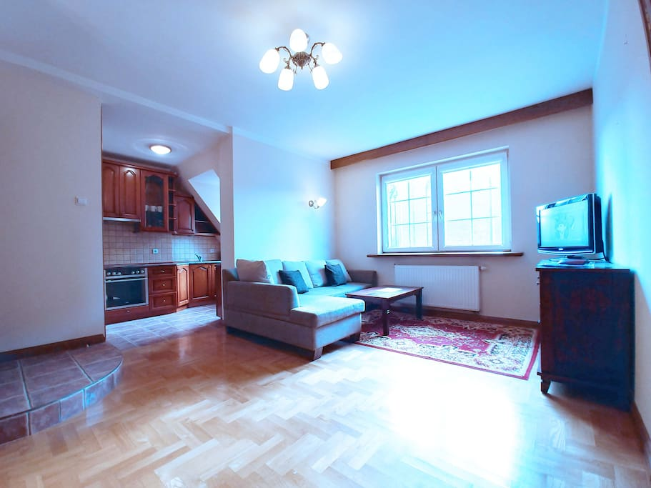 Living room with a double sofa bed, cable TV, large window overlooking the St. Mary's Basilica