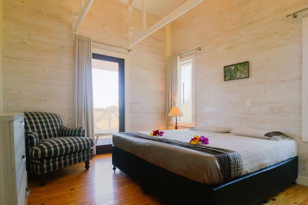 2 identical bedrooms - each bedroom includes 2 single beds, 1 dresser, and 1 private bathroom