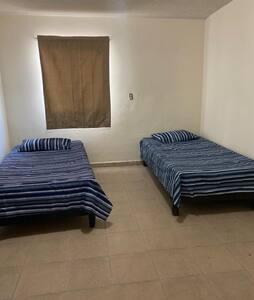 Habitación confortable, segura y buena ubicación
