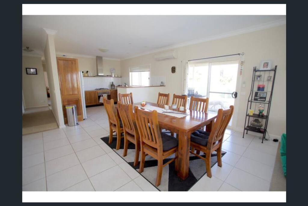 Large dining table to share                  stories with  friends