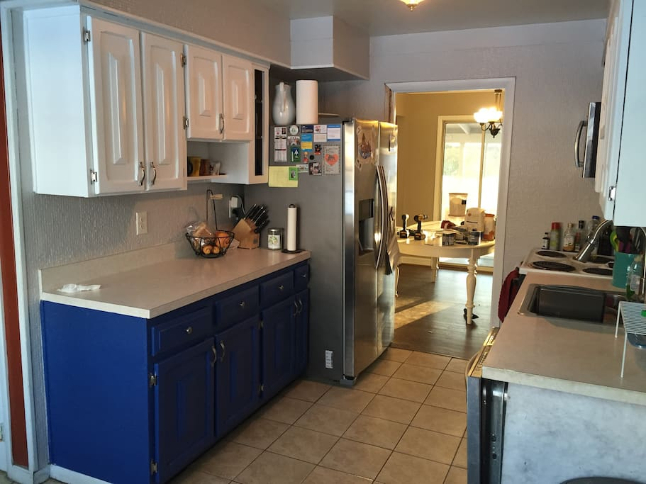 Galley kitchen with fridge, stove, microwave, dishwasher. Dishes provided.