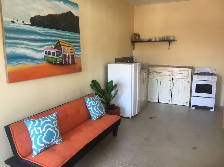 "Surf inspired apartment with full kitchen. ""The apartment is beautifully finished and has some great art on the wall too"" Arden"