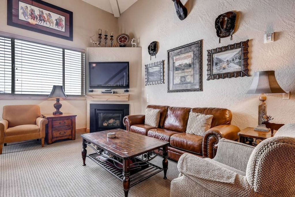 Spacious family / living room with gas fireplace, comfortable furnishings and modern-mountain accents.