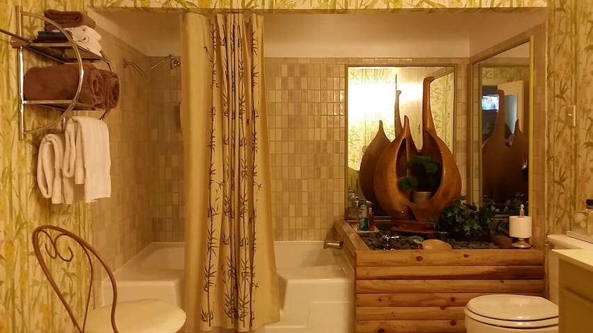 Huge bathroom with freshly resurfaced soaking tub (not jetted).  The perfect end to a busy day is a bubble bath.