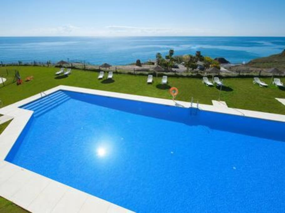 One of two superb pools with plenty of space to sun bathe