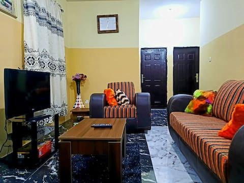 Homely and Serene 2-bedroom serviced apartment with free parking, within a Gated, well-secured Estate.