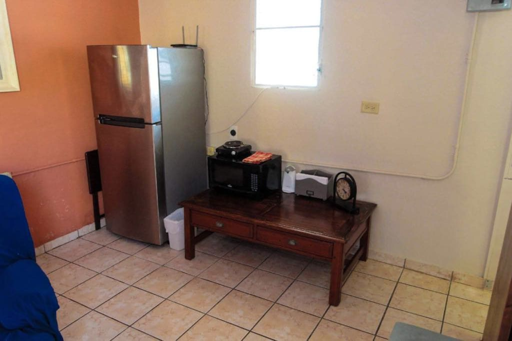 Refrigerator and microwave available.