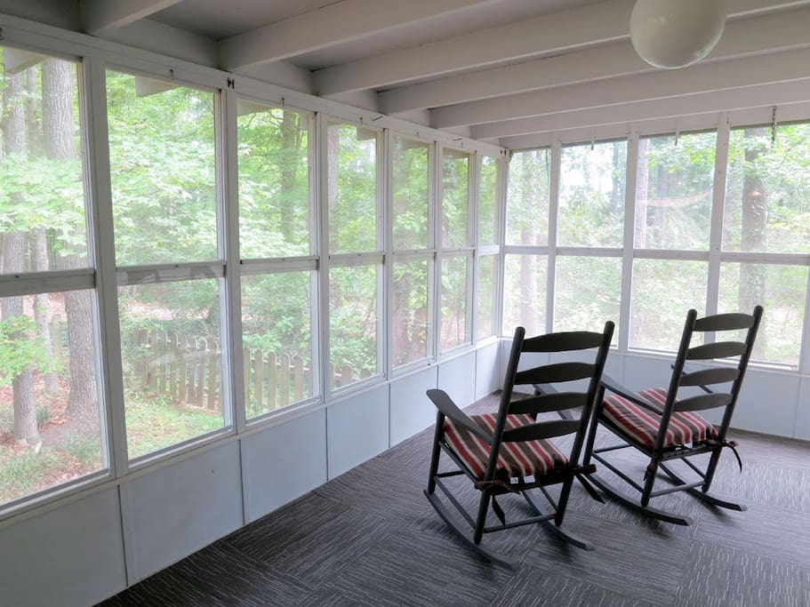 Screened back porch with 2 rockers and 2 deck chairs
