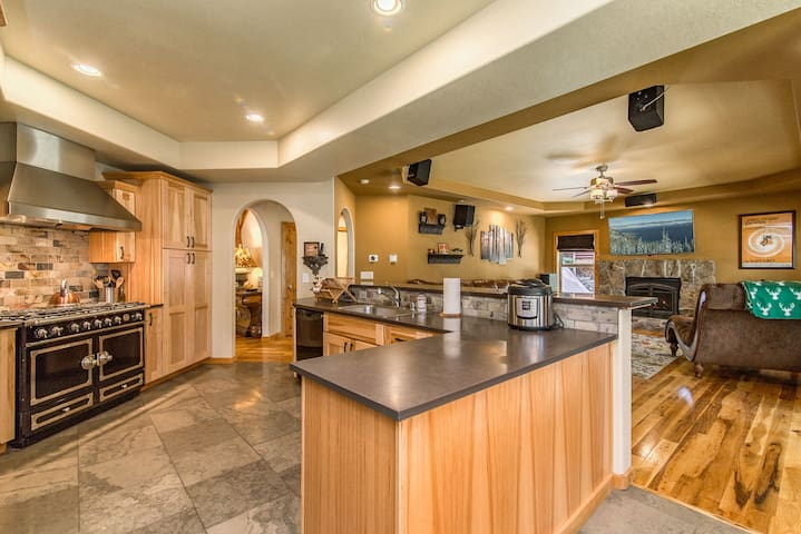 The kitchen features granite counters and a large island