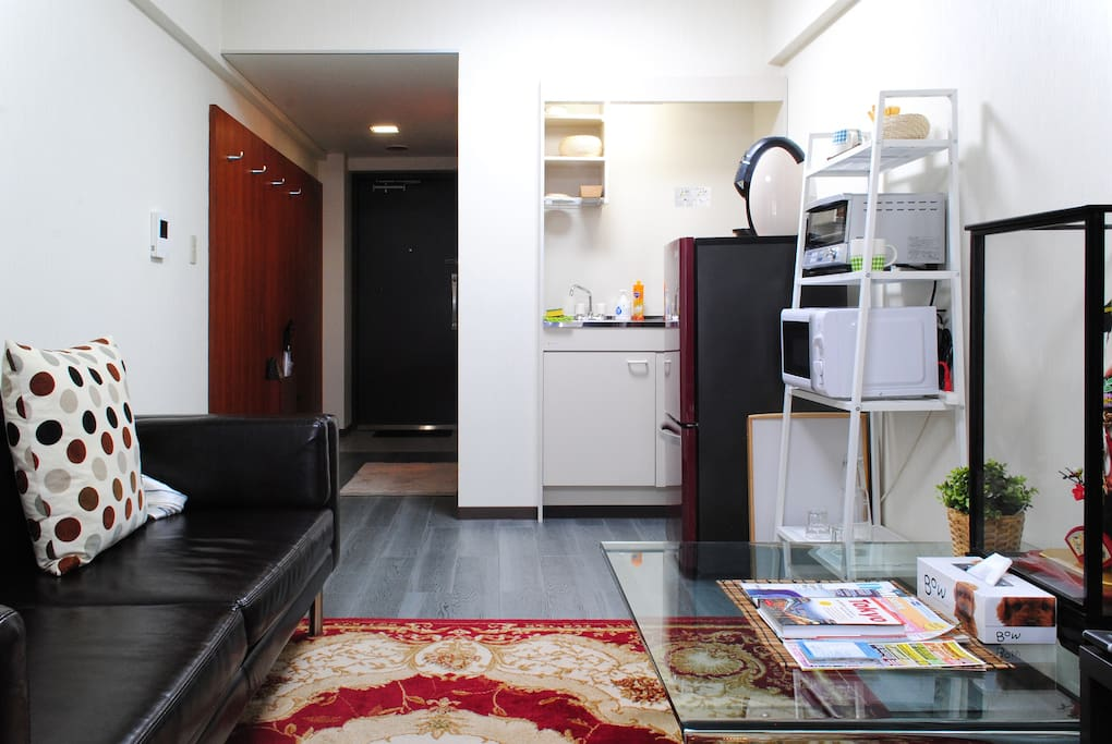 Fully equipped kitchenette and comfy sofa.
