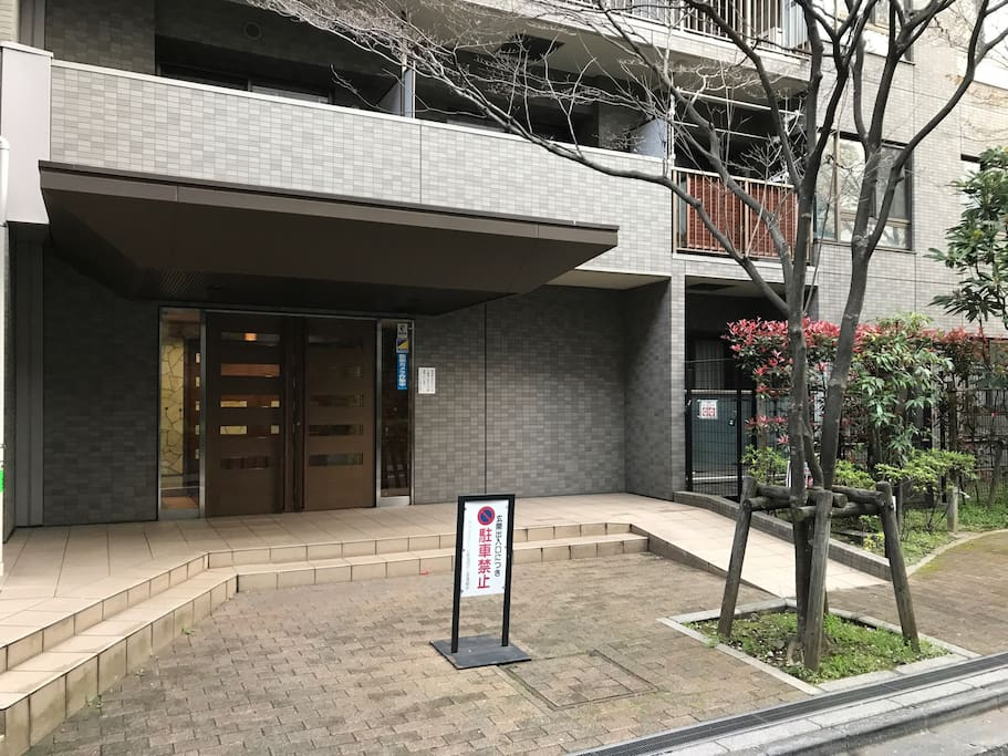 """This is a photograph of the entrance of the apartment. There is the key to entrance hall box which my room key entered in the right side of this apartment. This key box says """"RIN"""". Please look for this key box."""