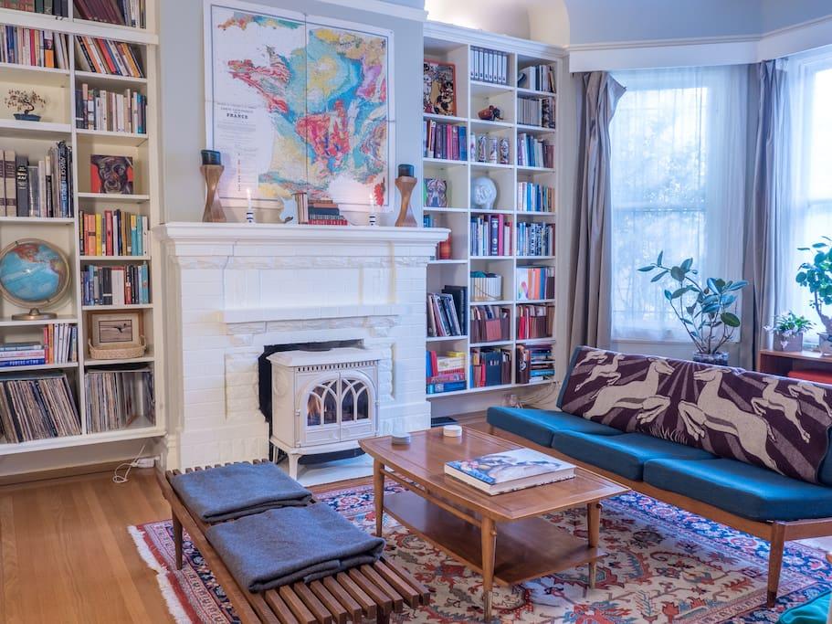 The sitting room has vintage mid-century modern furnishings and an ultra cozy gas fireplace.