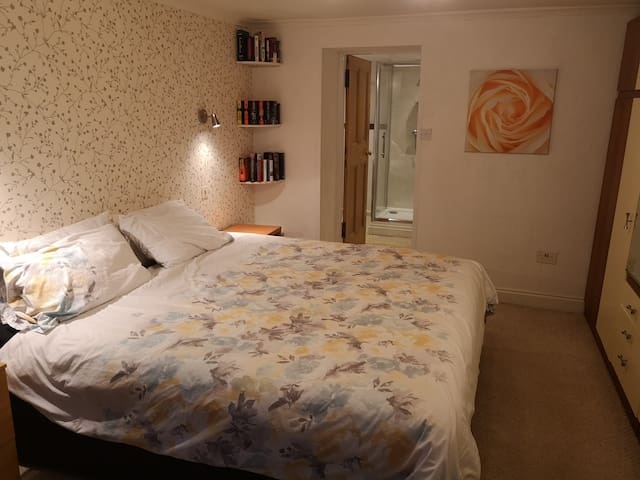 Superkingsize bed, loads of cupboard space, wall mounted bed side lights, kettle and beverages, hairdryer, free WiFi and local information brochures.