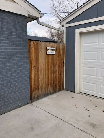 Gate that gives you access to the back yard and private entrance.
