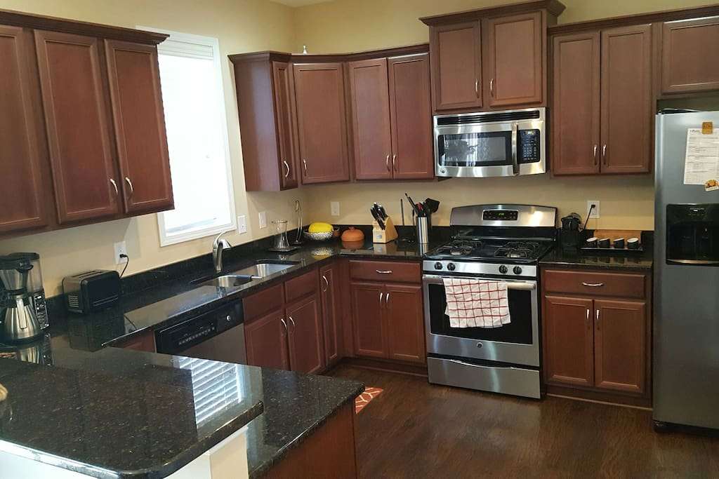 huge kitchen with gas stove, espresso maker and more