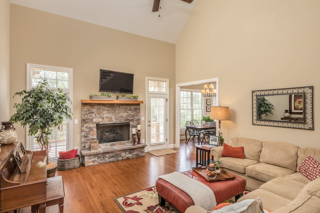 Relax and put your feet up in the spacious living room w/ gas log fireplace and HDTV.