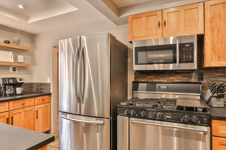 Kitchen with stainless steel appliances and commercial oven
