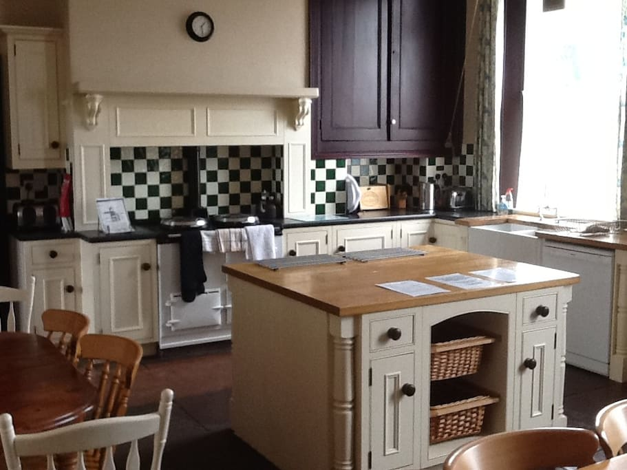 Kitchen with AGA cooker and room to dine.