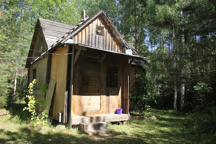 Guesthouse in the forest with bathhouse and pond