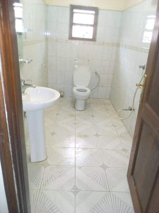 Bathroom with water heater, toilet