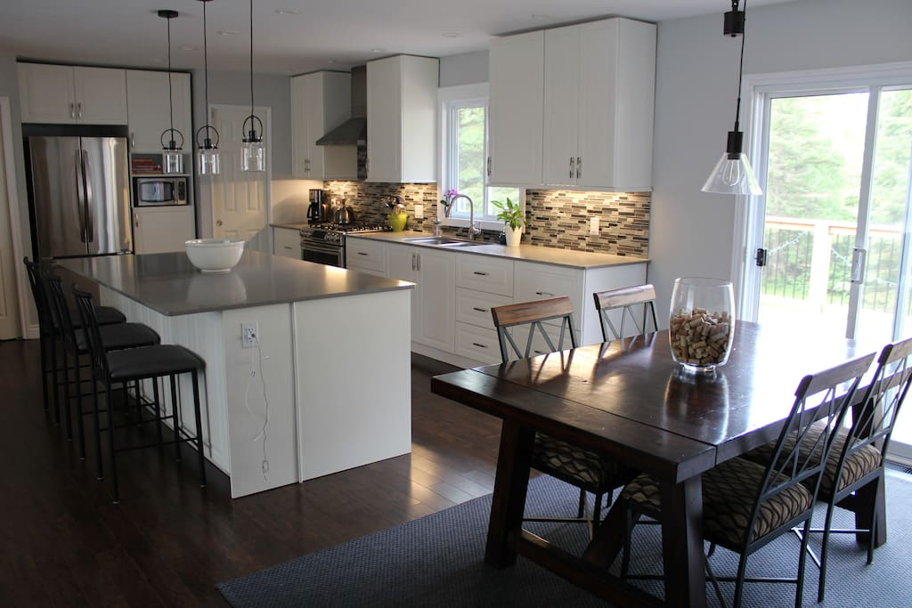 Open concept kitchen/dining room with sliding door to deck