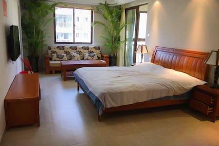 购物休闲兼备的温馨之家 - Wanning - Apartment