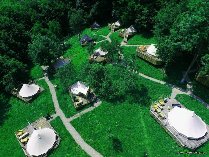 Glamping tents, traditional food, rafting