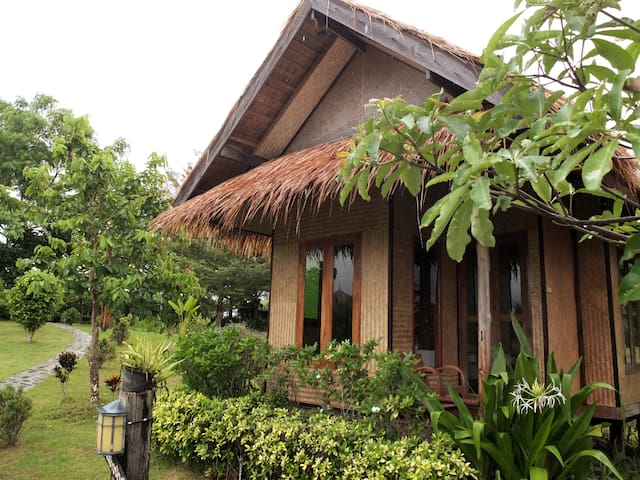 30 sq.m air-con cottage with private bathroom and hot shower.