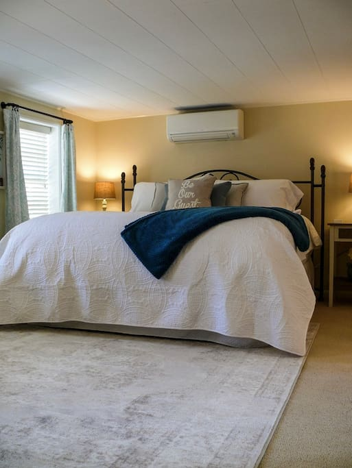 Master Bedroom with a plush, king size bed- you will never want to leave. Each nightstand has a USB port for your devices and the room has a soothing sound machine for those who enjoy the sounds of a fan, ocean waves, rain or white noise to sleep.
