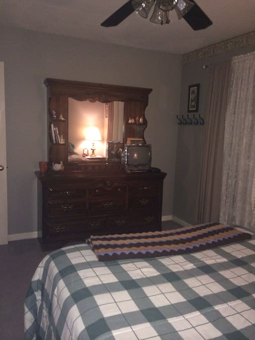 Front Guest Room:  Full dresser with mirror.  Plenty of hooks for your rob, jacket and towels.  TV with remote, cable and premium channels.