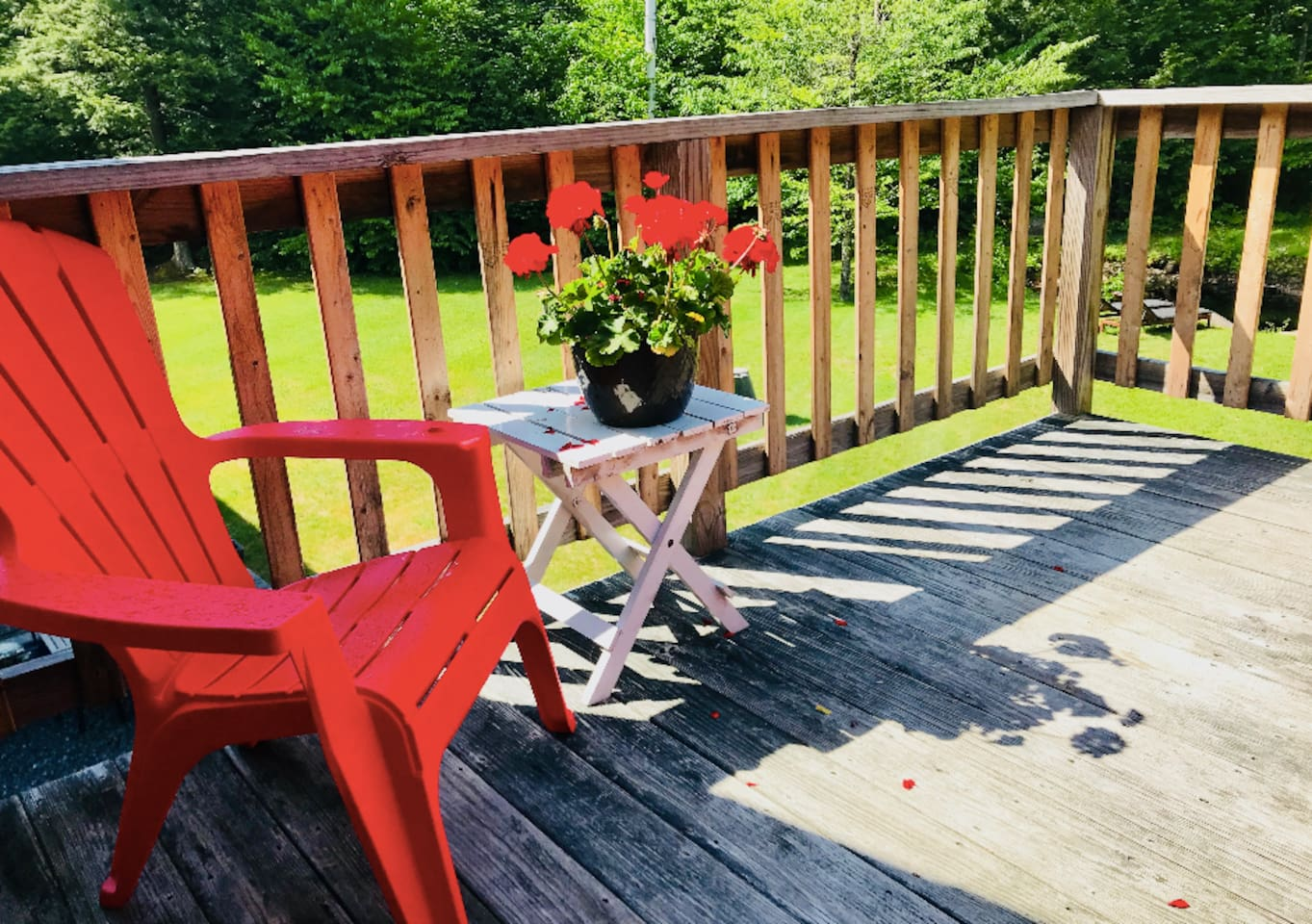 Private deck overlooks the backyard pond