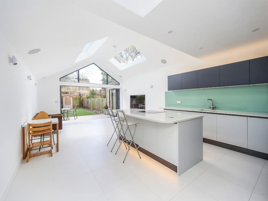 Brand new kitchen extension that opens onto garden with full width bi fold doors