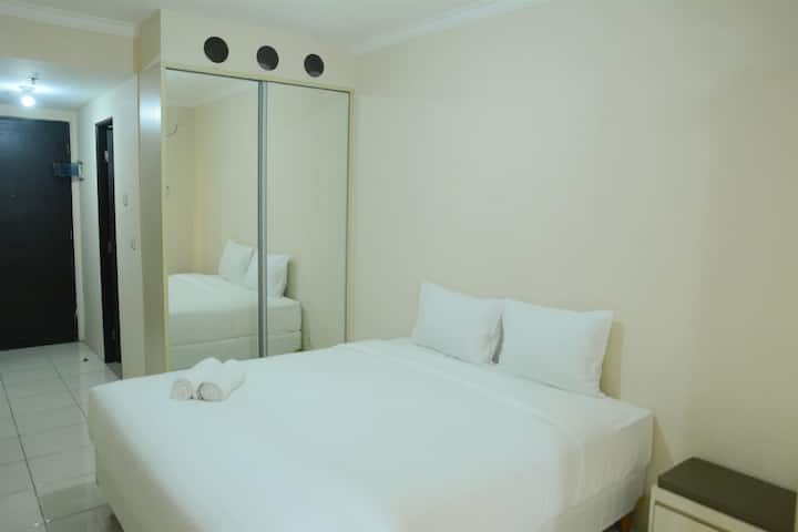 Minimalist Studio Room at Grand Serpong Apartment