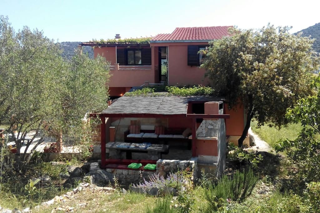 Back of hause with fireplace,nature , peace , Mediterranean atmosphere , the front of the house has a beautiful view of the near (3min walk)beach.You can enjoy the solitude , outside noise , and yet you are in the center and near sea.House has three terraces on different sides with a beautiful view:)
