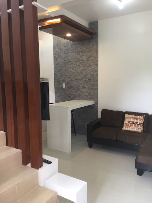 Minimalist Living Area, dining and kitchen at downstair of the apartment,  with tv and fully airconditioned.