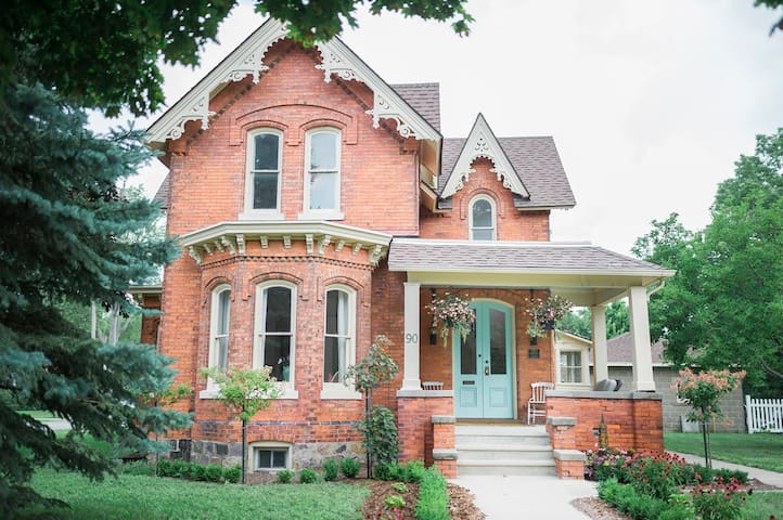 Built in 1886, our Gothic-revival style home is historically designated for its uniquely beautiful architectual features. The brick, the windows, the corbels, the dentil moulding... they just don't make em' like this anymore!