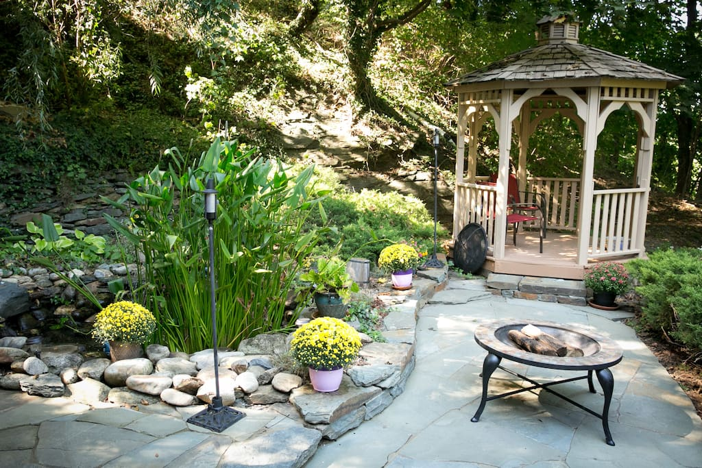 Side yard with pond, fire pit and gazebo