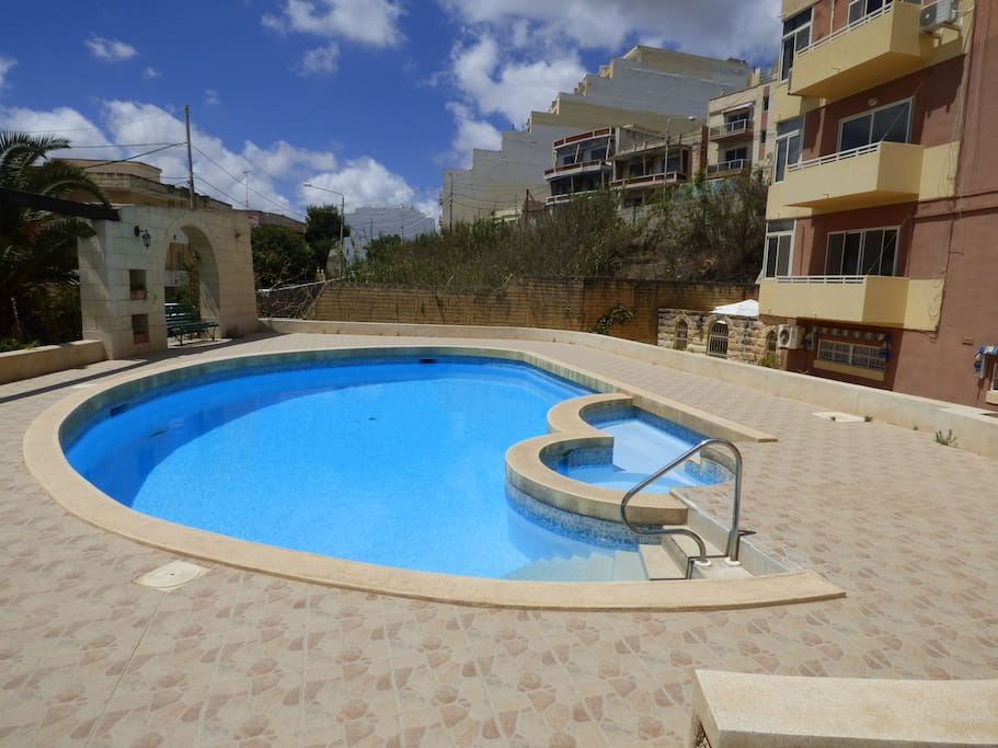 The swimming pool with splash area for younger members of the family. Wi fi also available by the pool.