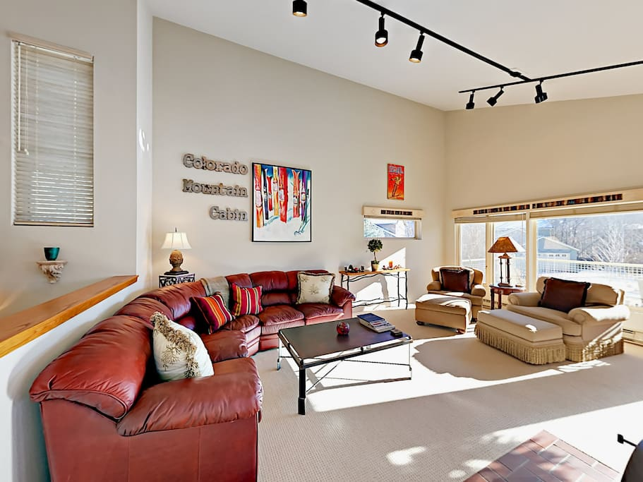The light-filled living room has vaulted ceilings and plenty of space to stretch out.