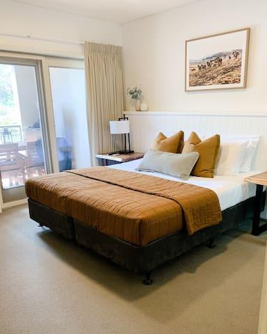 Main bedroom with king sized bed (also can be separated to become 2 single sized beds. Wake up to water views.