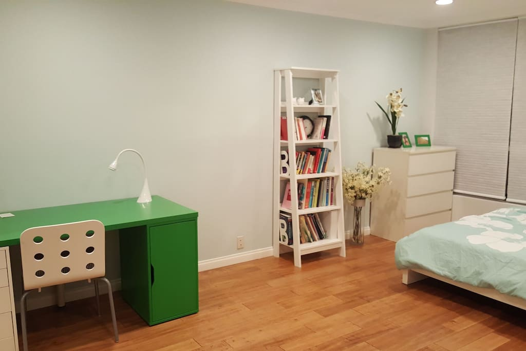 spacious private room with Queen size bed, desk, and closet
