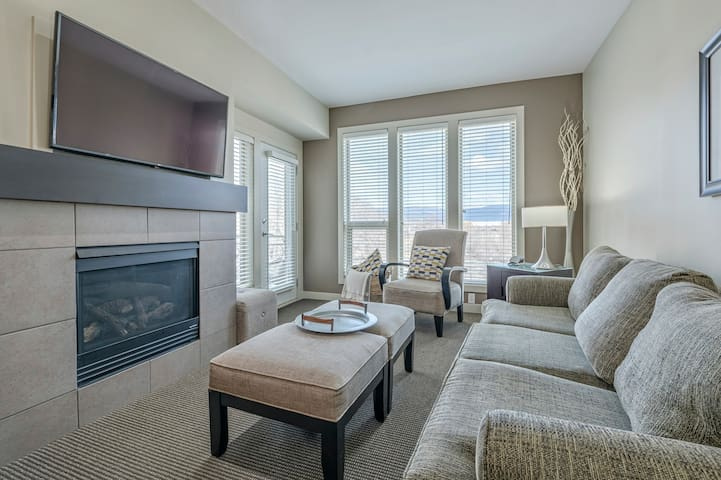 Living room with gas fire place and new 50 inch smart tv for relaxing.