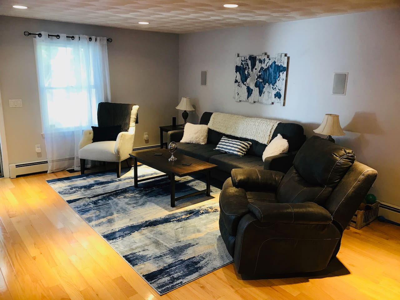 Main Living Room with TV with direct access to back yard