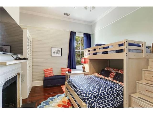 The second bedroom is cheery and bright and can accommodate up to three people.